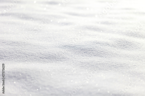 Beautiful sunny bright snow texture winter season copy space background. Selective focus used.