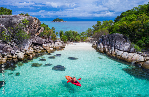 Fototapeta Aerial drone view of in kayak in crystal clear lagoon sea water during summer day near Koh Lipe island in Thailand