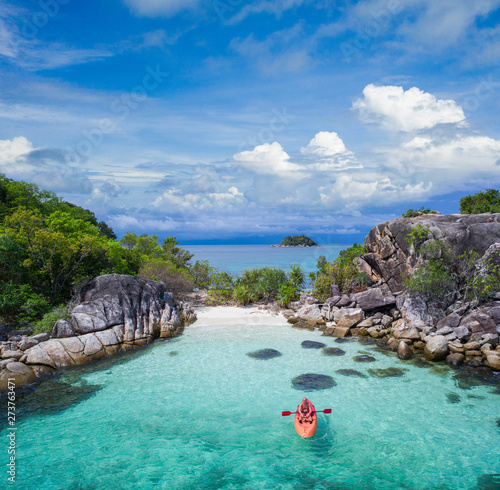fototapeta na lodówkę Aerial drone view of in kayak in crystal clear lagoon sea water during summer day near Koh Lipe island in Thailand. Travel tropical island holiday concept