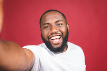 Say Cheese. Close Up Of Young Beautiful Dark-skinned Black Man In Casual Smiling With Teeth, Holding Smartphone, Making Selfie Photo.