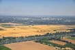 Sacramento downtown aerial from airplane, including view of rural surrounding farming and agricultural fields, river and landscape. California, United States.