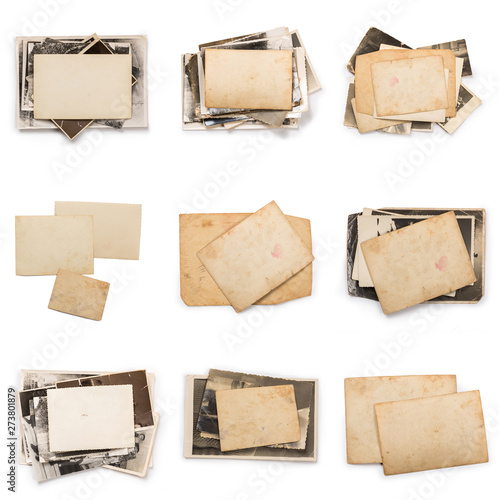 Fotomural  Stack of old photos with clipping path for the inside