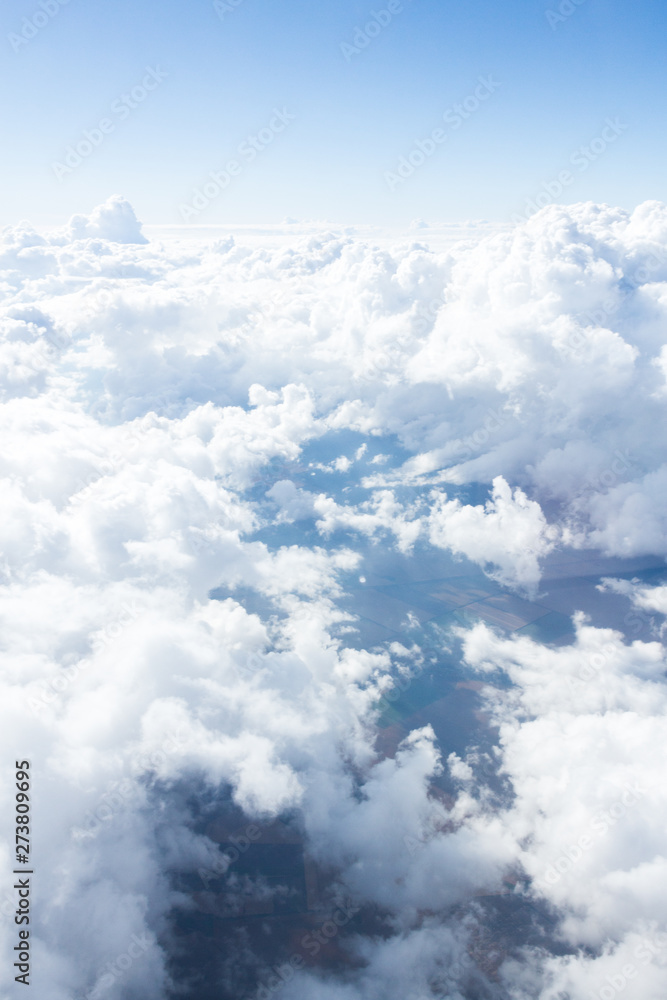 Fototapeta Clouds and sky from airplane window view