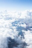 Fototapeta Na sufit - Clouds and sky from airplane window view