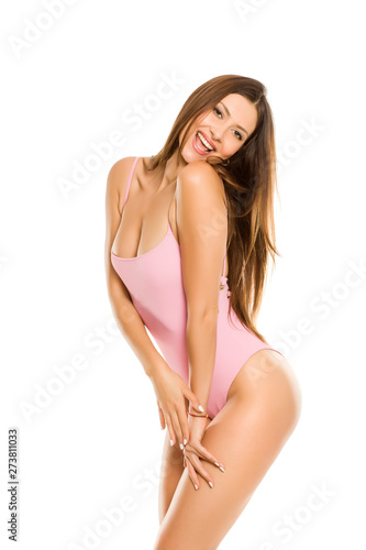 Fototapeta Young lady in one piece swimsuit and long hair posing on white background obraz
