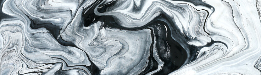 photography of abstract marbleized effect background. black and white creative colors. Beautiful paint. banner