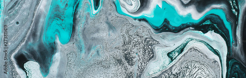 photography of abstract marbleized effect background. black, light turquoise and white creative colors. Beautiful paint. banner