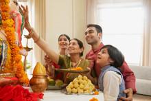 Family Perfoming Ganpati Aarti On Ganesh Chaturthi At Home