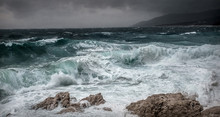 Stormy Sea View  Near Coastline At Evening Time. Waves, Splashed