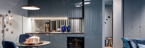 Blue apartment with open kitchen