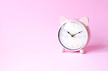 Pink Alarm Clock In The Form Of A Cat On A Pink Background.