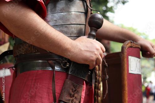 Carta da parati Legionary of Ancient Rome, close up of gladius and armor of infantry of Roman ar