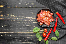 Frying Pan With Cooked Bacon On Dark Table