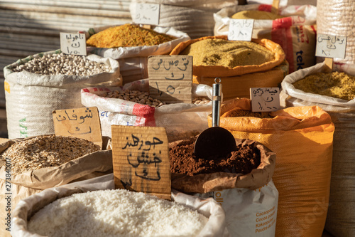 Stampa su Tela Spices, nuts and sweets shop on the market in Amman downtown, Jordan