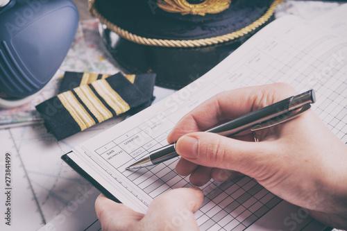 Fényképezés Airplane pilot filling in flight plan