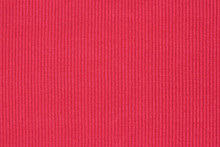 Ribbed Textile Material, In Fine-knit Stretch Fabric. Knitwear Texture. Amaranth Color Background.