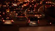 Paris, France - April 6, 2019: Car Traffic by night at Paris Parc Des Princes soccer stadium taken from bridge view. Lights, cars, fires, trees, bus, blur effect. Lot of vehicles. Blurred Tight Shot.
