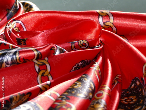 Red silk like satin shiny scarf with gold chain link design