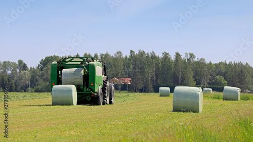 Foto op Plexiglas Weide, Moeras Baler Wrapper Baling Silage in Field