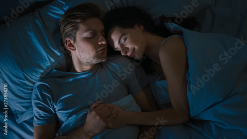 Top View Bed at Night: Attractive young Couple Sleeping Together, Holding Each other in Arms, Embracing Fototapete