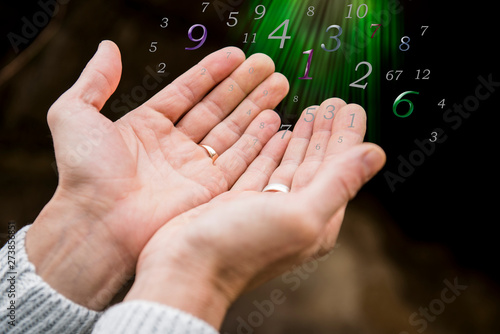 The numbers which are beautifully taking off from male hands, numerology Canvas Print