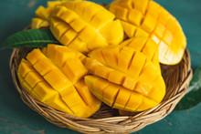 Mango In A Basket On A Green Wood