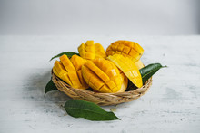 Mango In The Basket On White Wood Background