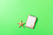 Leinwandbild Motiv blank notebook with seashell for summer holiday green background , Top view Flat lay concept