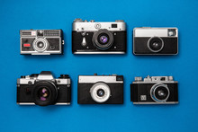 Vintage Camera Collection On Blue