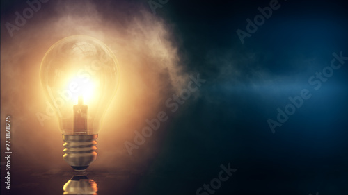 Fotomural  3d rendered illustration of Light Bulb with foggy blue Background