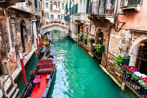 Foto auf Leinwand Venedig Scenic canal with gondolas and old architecture in Venice, Italy. famous travel destination