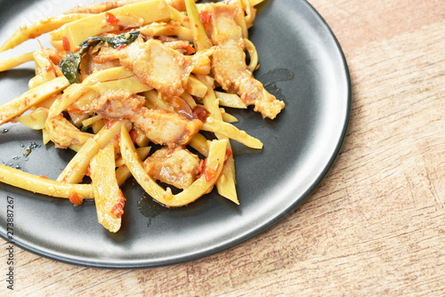 spicy stir fried bamboo shoot with crispy pork curry on plate - Buy