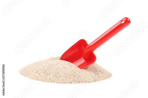Vászonkép Plastic beach toy with sand isolated on white background