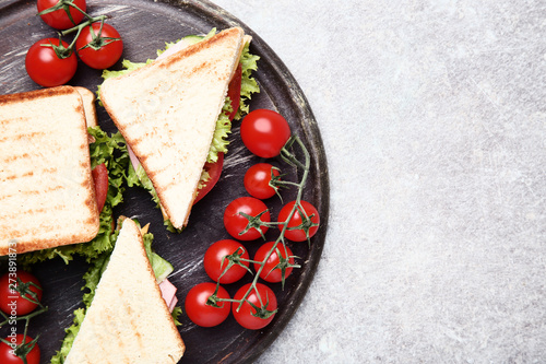 Fotografie, Obraz  Tasty sandwiches with vegetables on brown cutting board