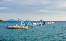 Pedal Boats Or Paddle Boats With Water Slides At Sea
