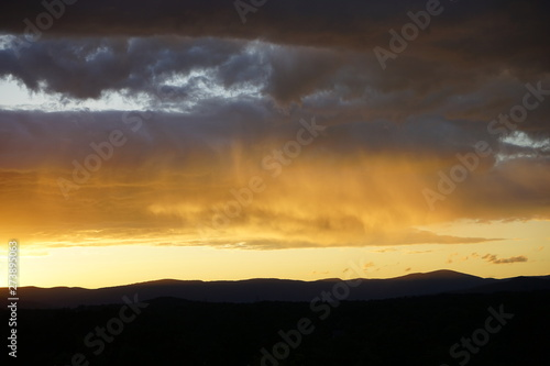 Sunset Over Mountains with Clouds