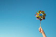 Child Holds Colorful Pinwheel
