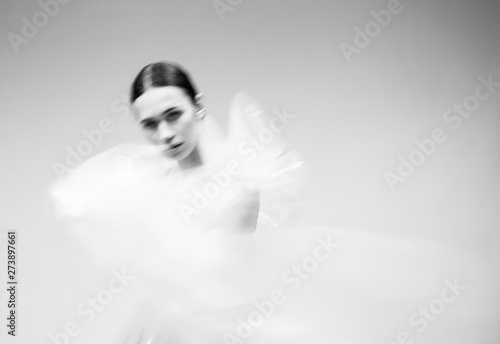 Canvas Print Black and white blurred portrait of a girl in polyethylene.