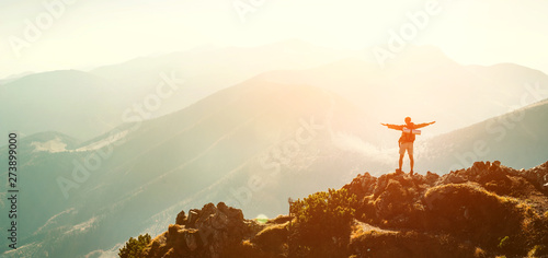 Foto auf AluDibond Weiß High Mountain hiker with backpack tiny figurine stands on mountain peak