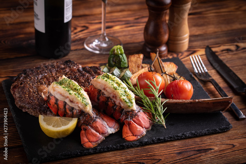 Fotomural surf and turf with tomahawk rib eye steak and lobster tail