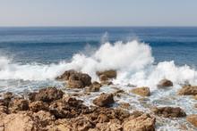 Powerful Waves Splashing On A Rocky Beach Of Cyprus