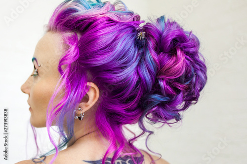 Incredible hair color, bright blue and Magenta gradient. Stylish fashionable hair coloring.