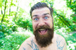 Summer madness. Man cheerful bearded hipster taking selfie in wild nature. Guy crazy emotional face surviving in hot forest. Summer vacation concept. Having fun. Blogger summer natural environment