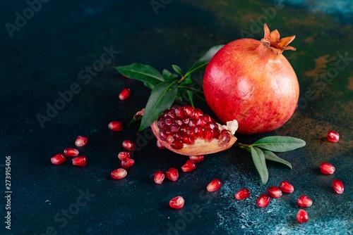Fototapeta Red juice pomegranate on dark background