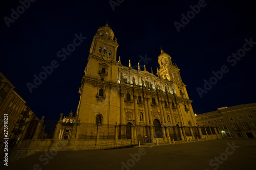 Jaen cathedral illuminated at night. Summery image with the empty streets of the city of Jaen in Spain
