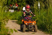 The Little Girl Rides A Quad B...