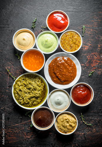 Fototapeta Barbecue sauce, pesto, mayonnaise, mustard with thyme sprigs. obraz