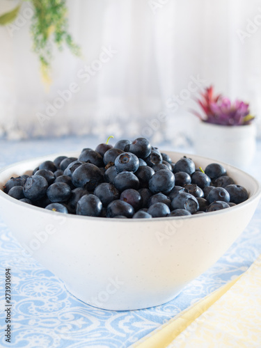 Fresh picked blueberries in a light and bright kitchen environment.