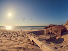 France, Contis Plage, Kite Surfers On Sandy Beach