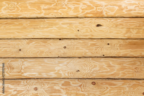 Fotografija  Wooden wall of house from logs.  Natural background and pattern.